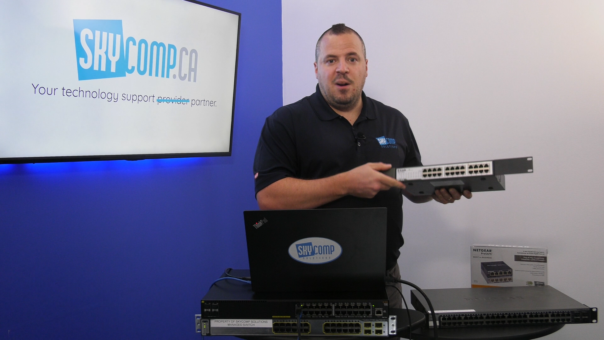 Marc from Skycomp Solutions Holding a switch