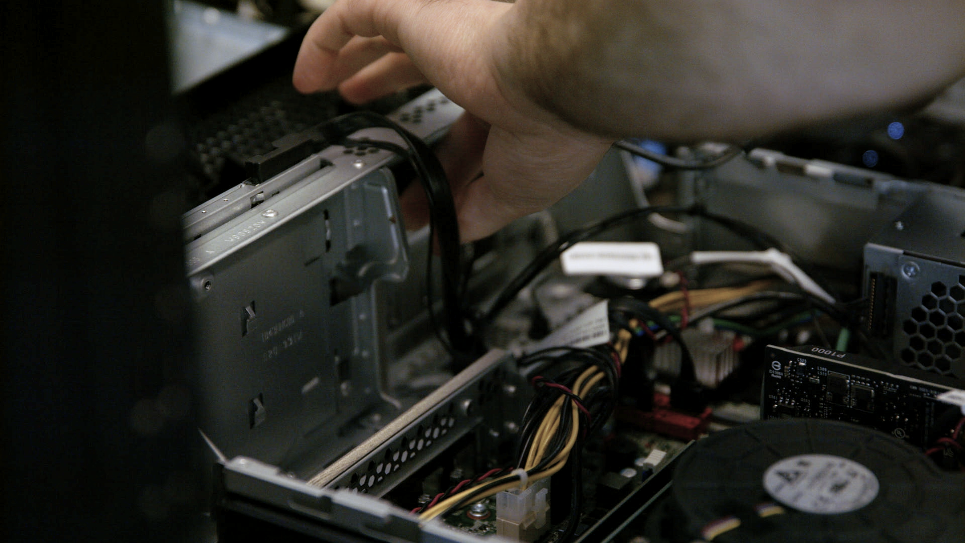 Someone fixing the internal parts of a computer